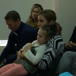 Olympian Noelle Pikus-Pace holds her daughter while attending LDS Church services Sunday in Sochi, Russia.