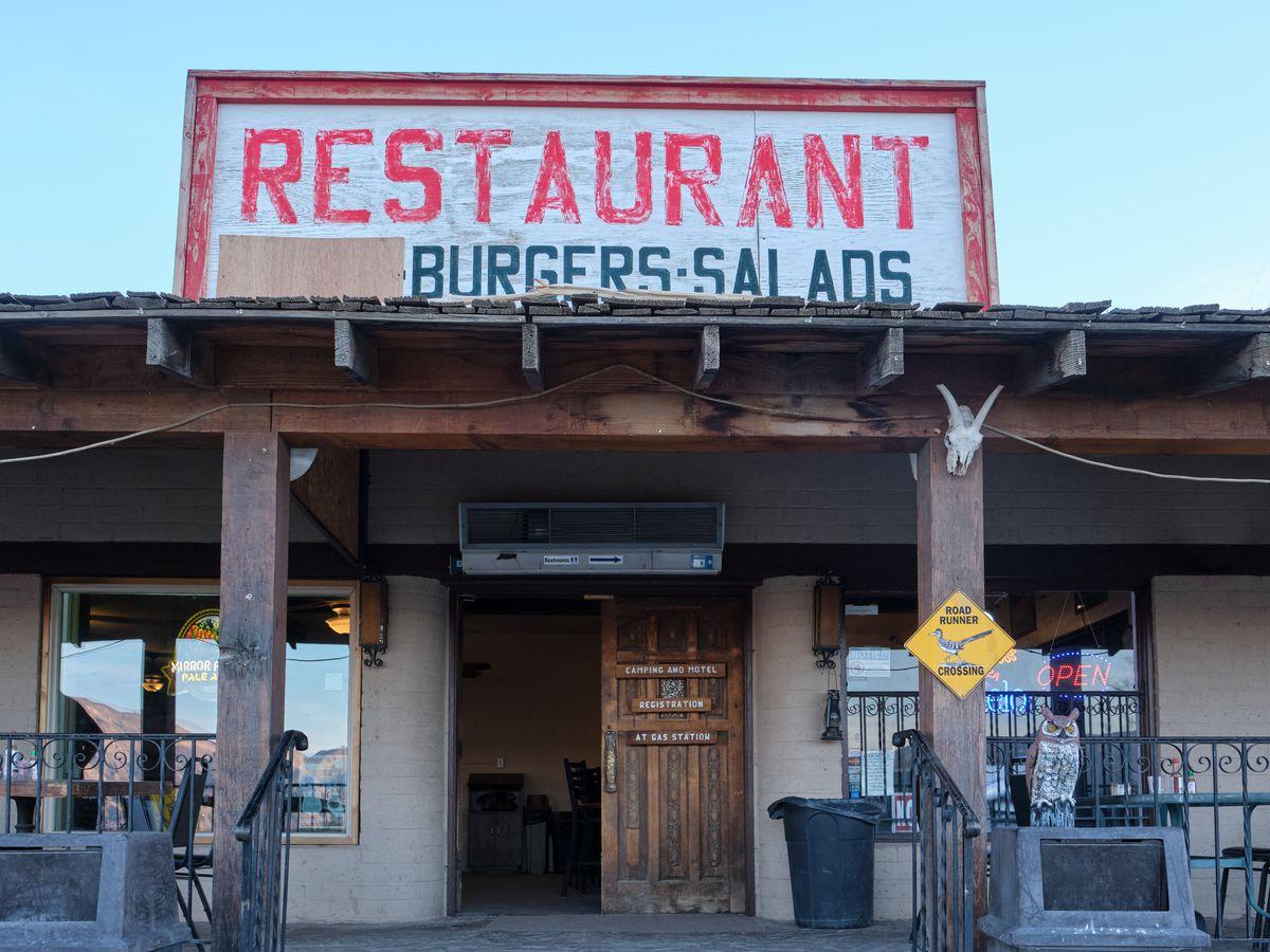 Restaurant exterior with sign reading Restaurant Burgers Salads