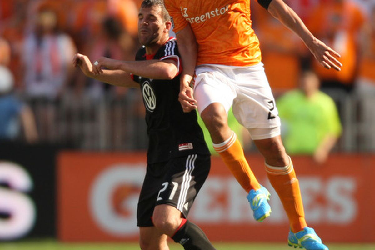 Corey Ashe and Daniel Woolard battle during the previous meeting between the Dynamo and United