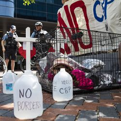 Immigrant rights activists protest outside the Marriott Marquis Chicago while U.S. Customs and Border Protection hosts the 2019 Trade Symposium on Tuesday.