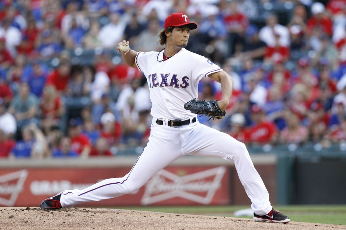 June 15, 2012; Arlington, TX, USA; Texas Rangers starting pitcher Yu Darvish (11) throws to the Houston Astros in the first inning at Rangers Ballpark in Arlington. Mandatory Credit: Jim Cowsert-US PRESSWIRE