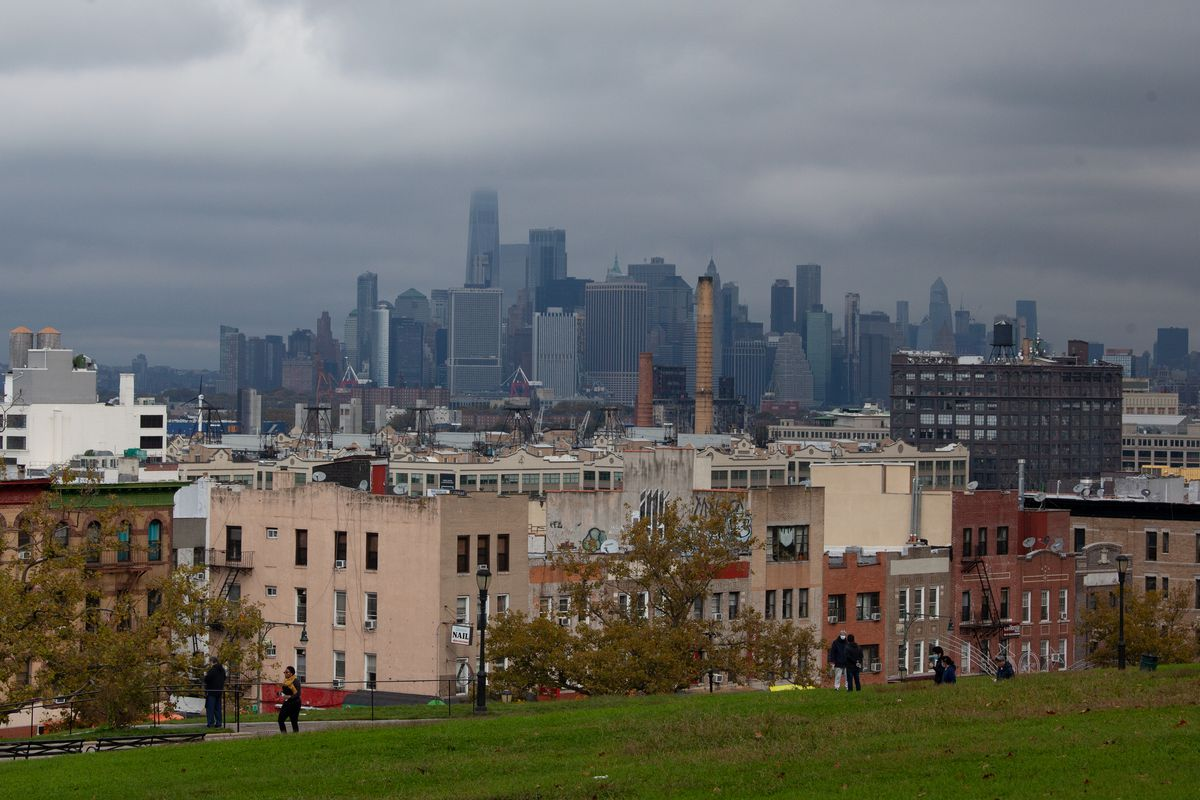 People enjoy the view in Sunset Park, Brooklyn, Oct. 27, 2020.