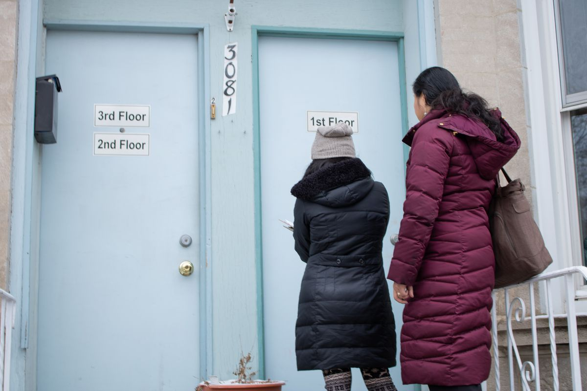 Grace Chan, left, and Michelle Gan knocked on homes in Bridgeport to tell residents about the upcoming 2020 census.