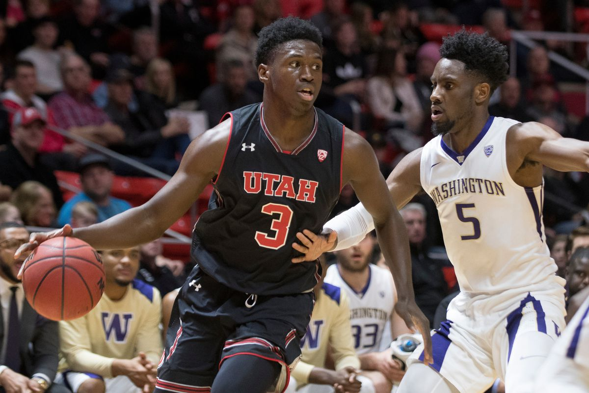 Utah forward Donnie Tillman handles the ball while being guarded by Washington guard Jaylen Nowell during the Utes' 70-62 win against the Washington Huskies at the Jon M. Huntsman Center in Salt Lake City on Thursday, Jan. 18, 2018.