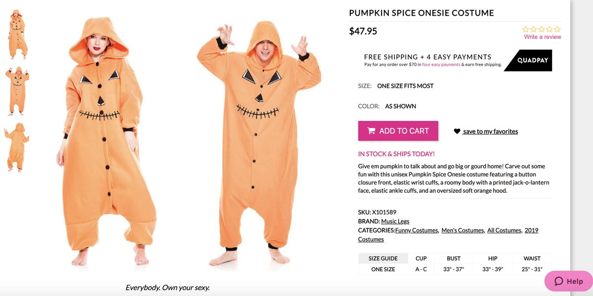 A man and a woman dressed in pumpkin onesie jump suits.