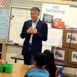 Former U.S. Ambassador to China and Former Governor of Utah and current Chevron Board of Directors Member Jon M. Huntsman, Jr., speaks to fourth graders before helping them unwrap STEM related teaching materials at Rose Park Elementary in Salt Lake City on Wednesday, Aug. 30, 2014.