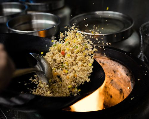 Fried rice being cooked in a wok.