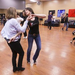 South Salt Lake Businesswoman of the Year Maria Ivanova works with Carlie Shurtliff Tuesday, March 12, 2013, as they work with her students at her dance studio, DF Dance.