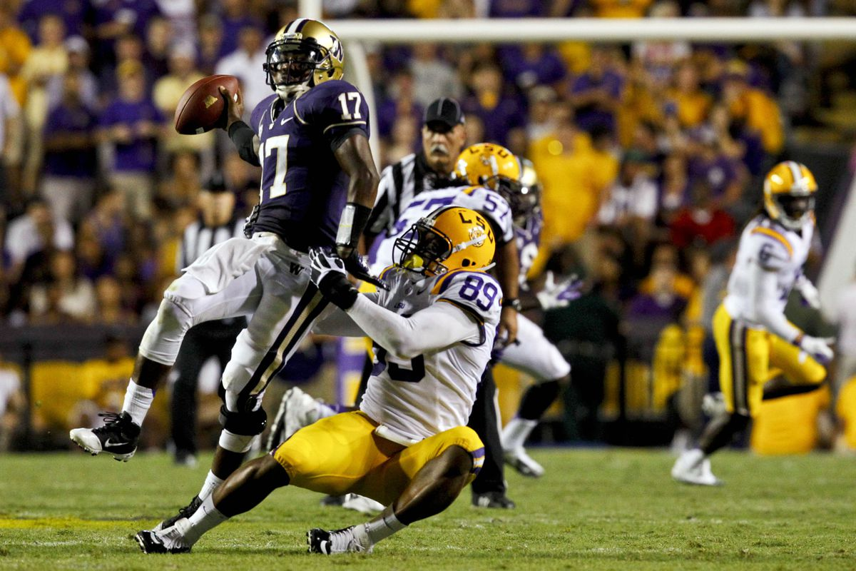 September 8, 2012; Baton Rouge, LA, USA; Washington Huskies quarterback Keith Price (17) escapes from LSU Tigers defensive end Lavar Edwards (89) during the first half of a game at Tiger Stadium.  Mandatory Credit: Derick E. Hingle-US PRESSWIRE