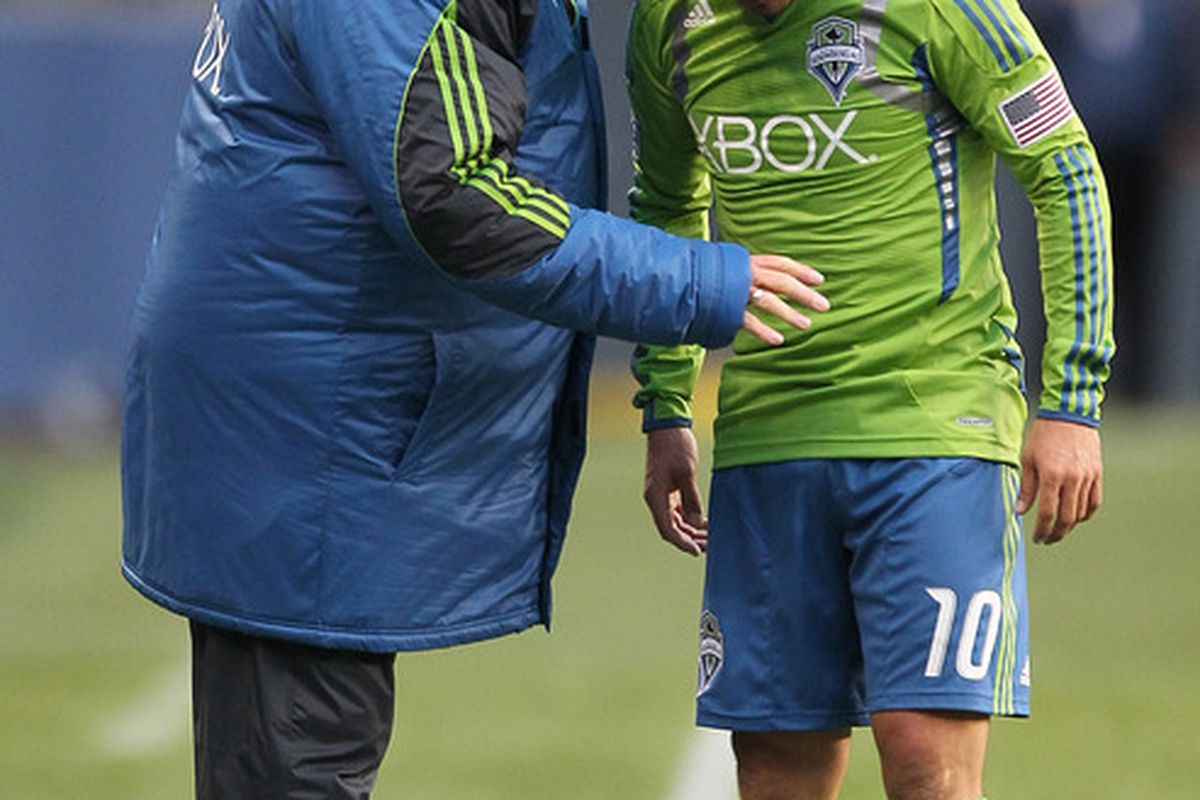 Sigi consoling Mauro Rosales after he got too close to the Smolderings in Seattle's 1-0 loss to FC Dallas on Wednesday night.