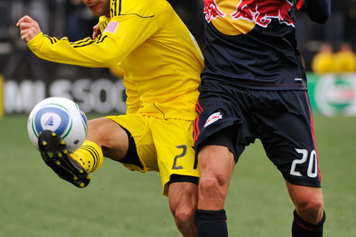 COLUMBUS, OH - MARCH 26:  Sebastian Miranda #21 of the Columbus Crew gets control of the ball in front of Joel Lindpere #20 of the New York Red Bulls on March 26, 2011 at Crew Stadium in Columbus, Ohio.  (Photo by Jamie Sabau/Getty Images)