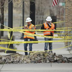 First responders look at damage to a building in Magna after a 5.7 earthquake hit early Wednesday, March 18, 2020.