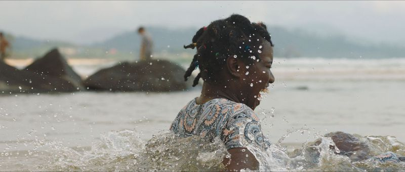 A young girl splashes in water.