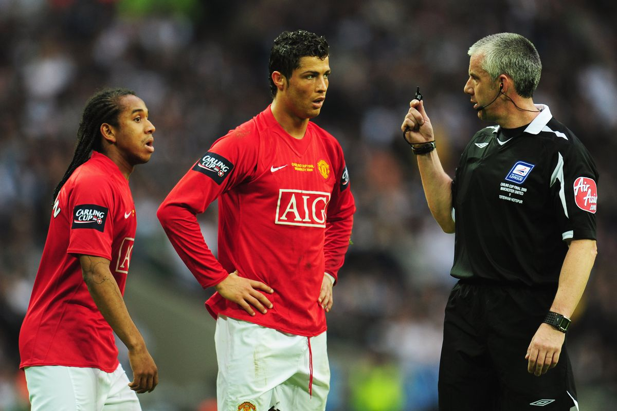 Referee Chris Foy signals to Cristiano Ronaldo and Anderson of Manchester Unitedduring the Carling Cup Final match between Manchester United and Tottenham Hotspur at Wembey Stadium on March 1, 2009 in London, England.