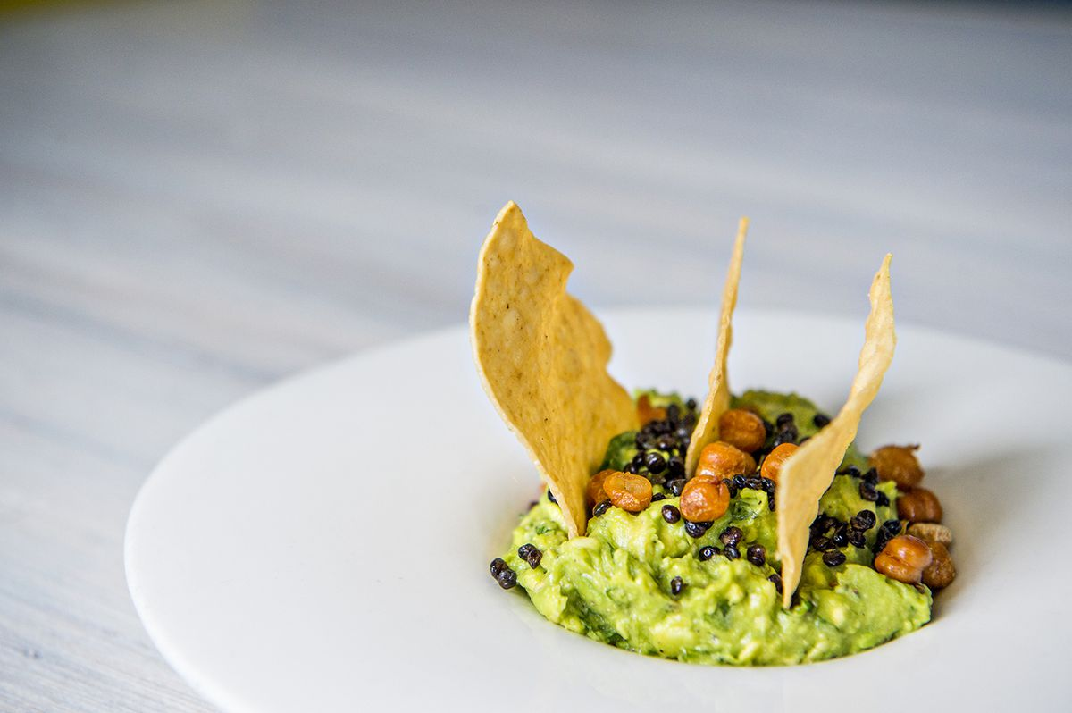 The Lola guacamole is prepared table side with fried lentils and spicy chickpeas.