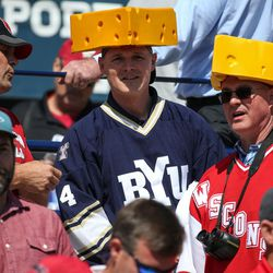"""A Brigham Young Cougars fan and a Wisconsin Badgers fan wear """"cheeseheads"""" before the game at LaVell Edwards Stadium in Provo on Saturday, Sept. 16, 2017."""
