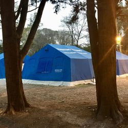 Tents are set up on the complex of a Red Cross refugee camp.