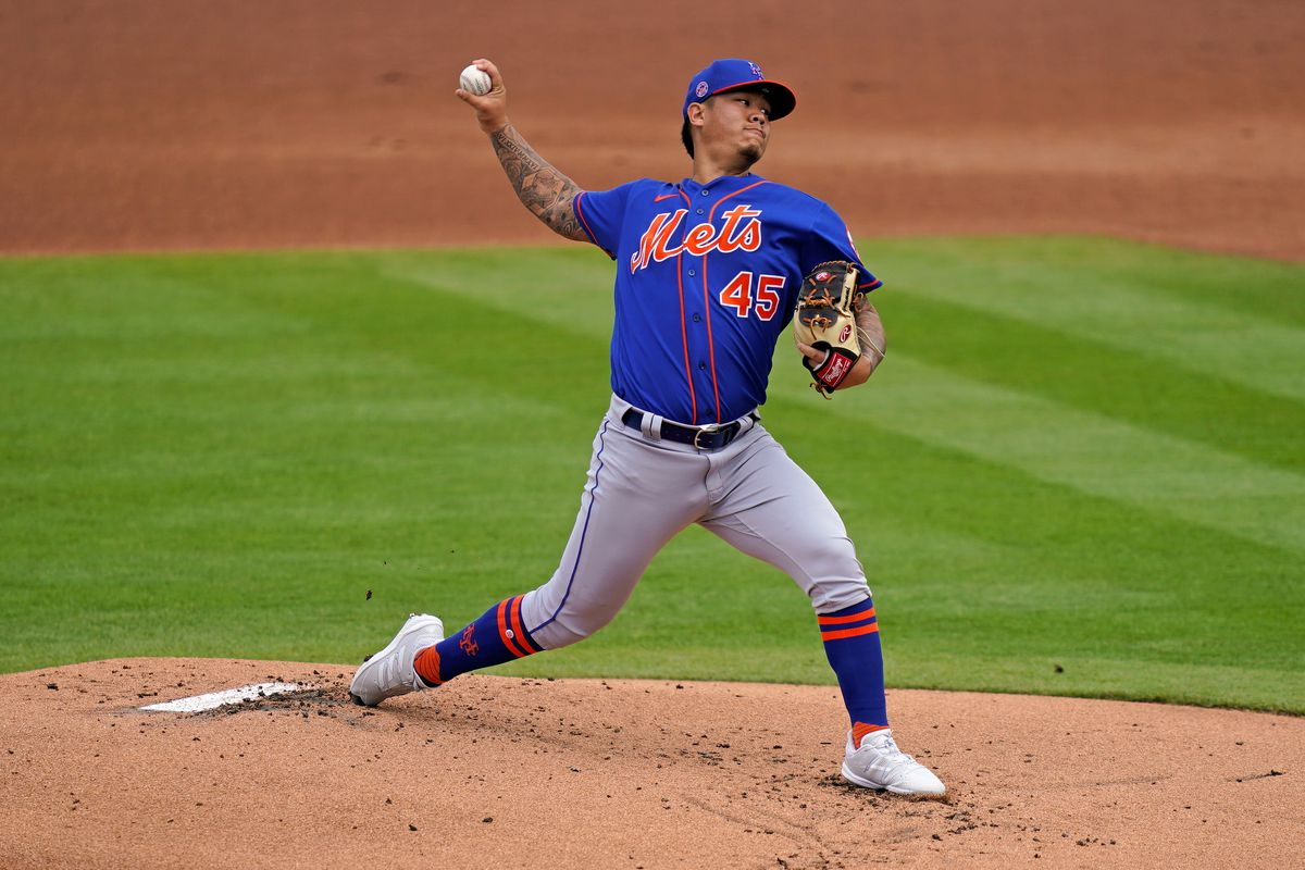 New York Mets starting pitcher Jordan Yamamoto (45) delivers a pitch in the 1st inning of the spring training game against the Washington Nationals at The Ballpark of the Palm Beaches.