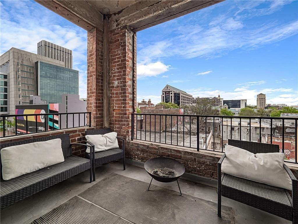 a covered balcony with views of downtown Atlanta.