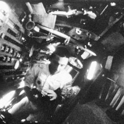Lt. Col. William A. Anders, Apollo 8 lunar module pilot, gets his camera ready to take some photographs during the spaceflight, Dec. 30, 1968.