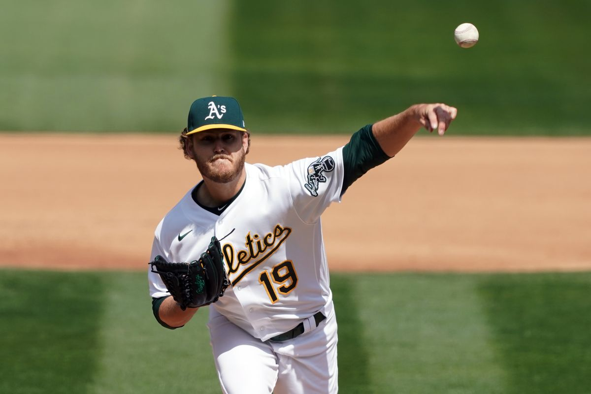Oakland Athletics starting pitcher Cole Irvin (19) throws a pitch during the fourth inning against the Houston Astros at RingCentral Coliseum.