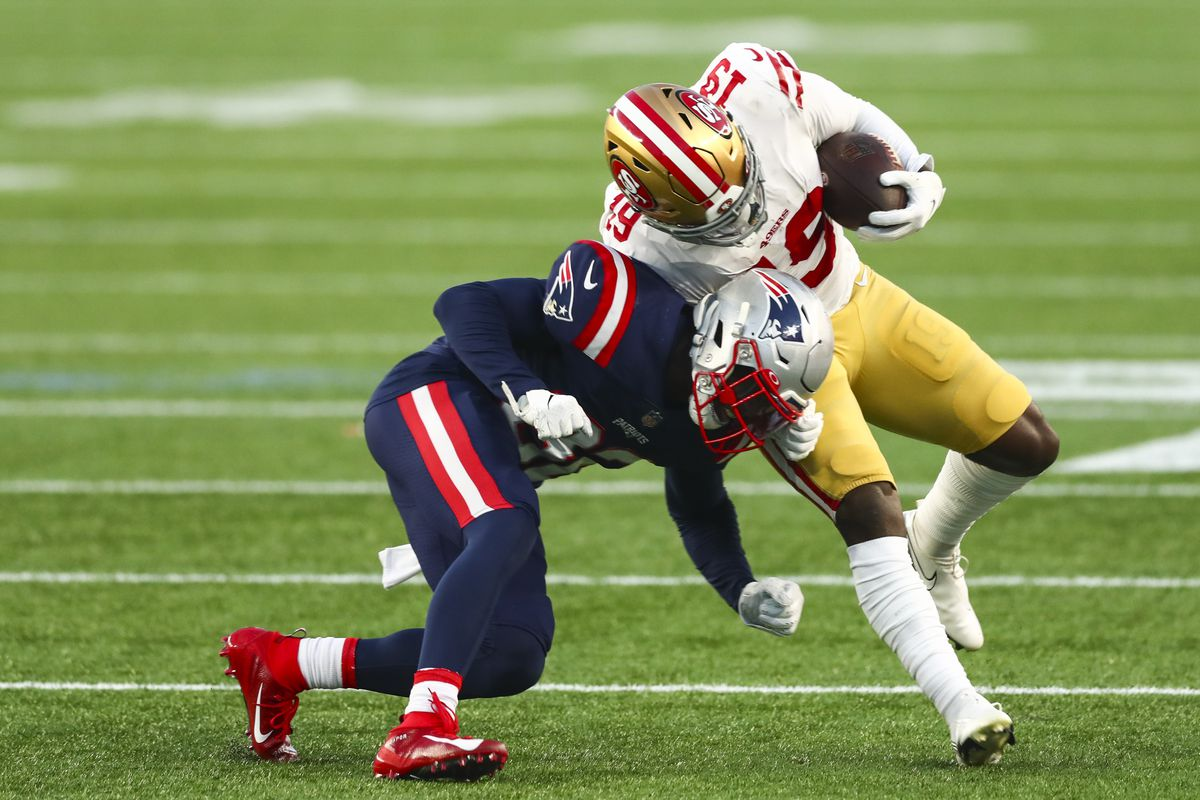 Deebo Samuel #19 of the San Francisco 49ers is tackled with the ball during a game against the New England Patriots on October 25, 2020 in Foxborough, Massachusetts.