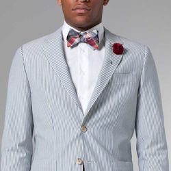 """<a href=""""http://www.indochino.com/product/the-ultimate-blue-seersucker-blazer"""">Blue Seersucker Blazer</a>, $329; <a href=""""http://www.indochino.com/product/White-Essential-WrinkleFree-Shirt"""">White Essential Shirt</a>, $79; <a href=""""http://www.indochino.com"""