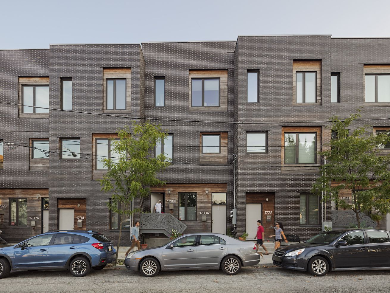 """In Philadelphia, the architecture firm ISA looks for ways new housing can address other equity challenges, like public health, access to open space, and emotional well-being. Its Powerhouse project, a 31-unit infill development completed in 2014, includes the """"super stoops"""" and street furniture that encourage social engagement among neighbors and passersby."""