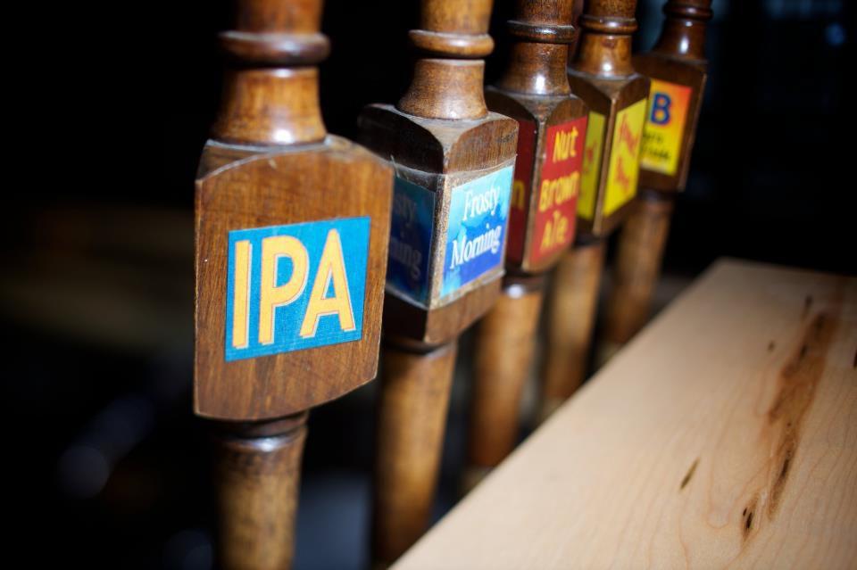 A line of beer taps.