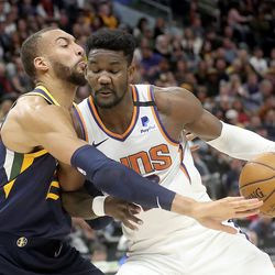 Utah Jazz center Rudy Gobert (27) guards Phoenix Suns center Deandre Ayton (22) during an NBA game at the Vivint Smart Home Arena in Salt Lake City on Monday, Feb. 24, 2020.