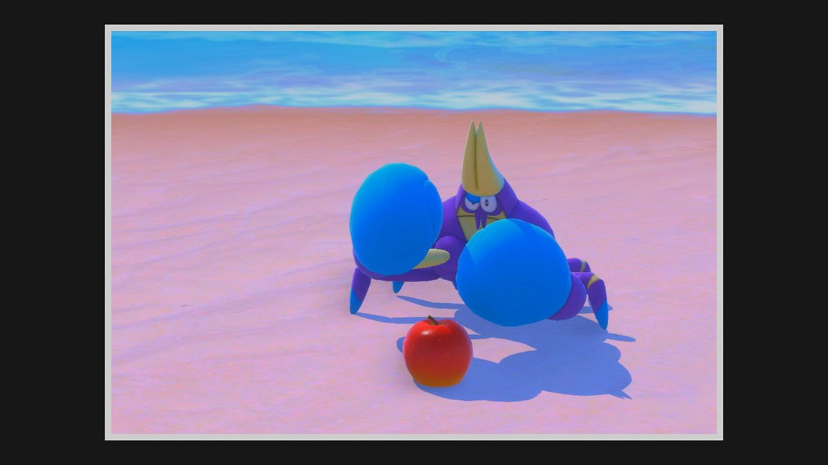 Crabrawler stands on a beach with its claws up, in front of a Fluffruit