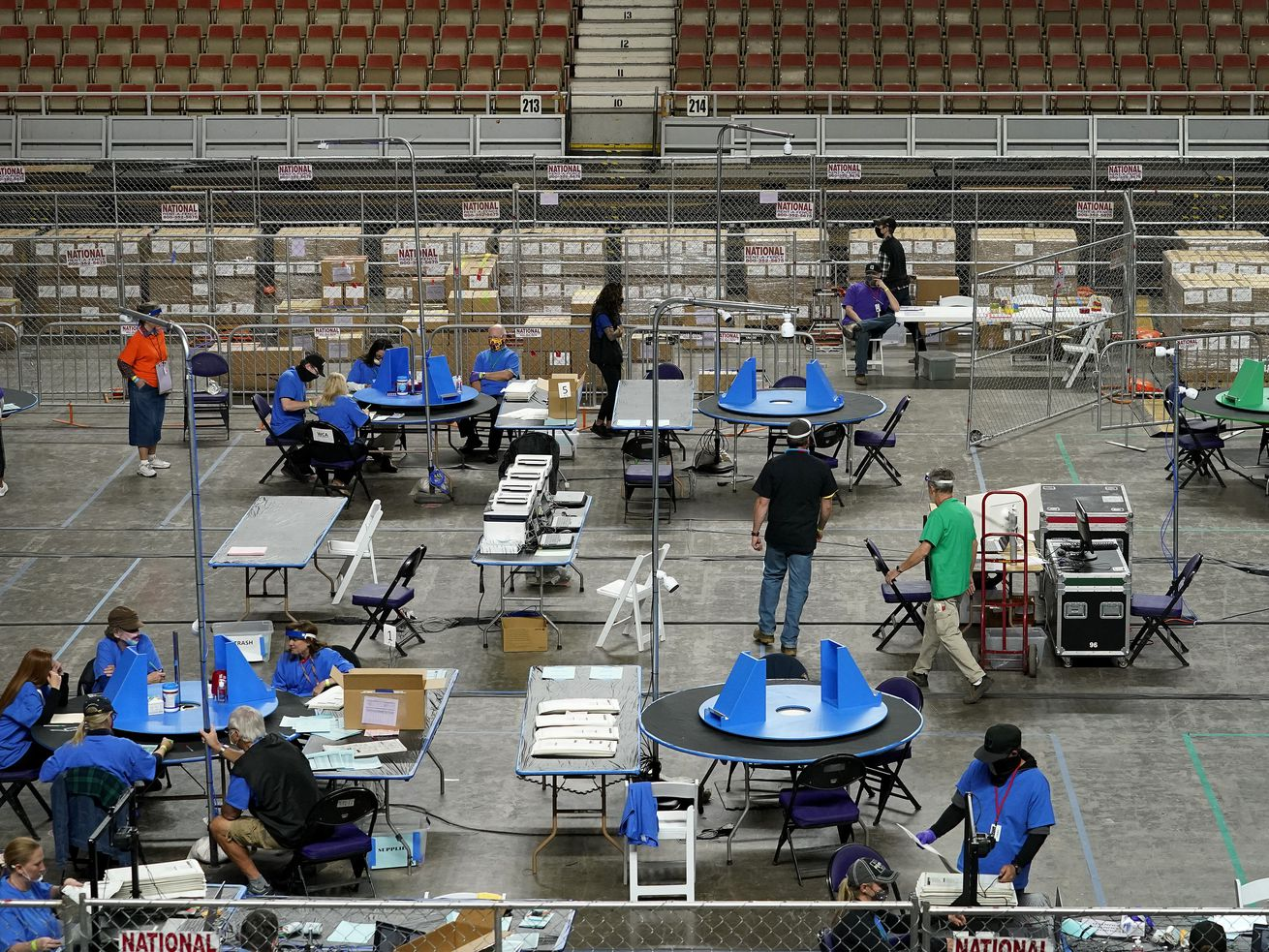 Maricopa County ballots cast in the 2020 general election are examined and recounted by contractors working for Florida-based company, Cyber Ninjas, Thursday, May 6, 2021 at Veterans Memorial Coliseum in Phoenix.