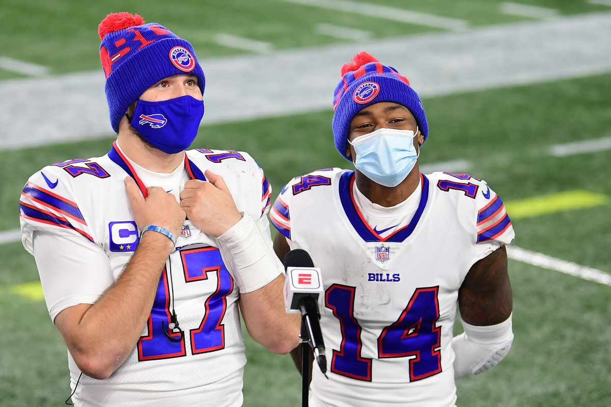 Josh Allen and Stefon Diggs of the Buffalo Bills react after a game against the New England Patriots at Gillette Stadium on December 28, 2020 in Foxborough, Massachusetts.
