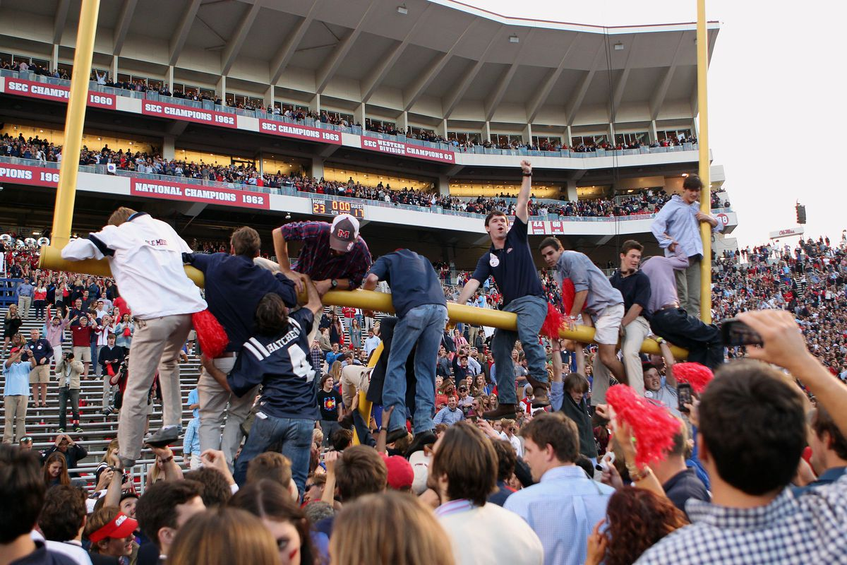 Ole Miss fans tear down the goal posts after the Rebels' win over Alabama.