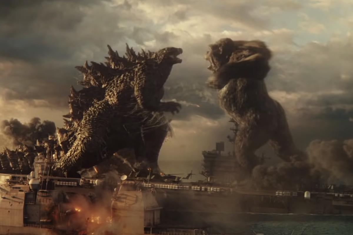 Godzilla fights Kong on an aircraft carrier