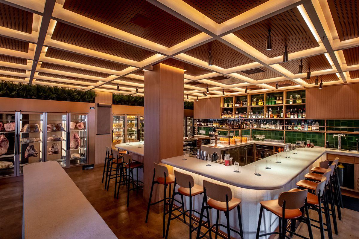 A U-shaped bar dominates the dining room at Wayo