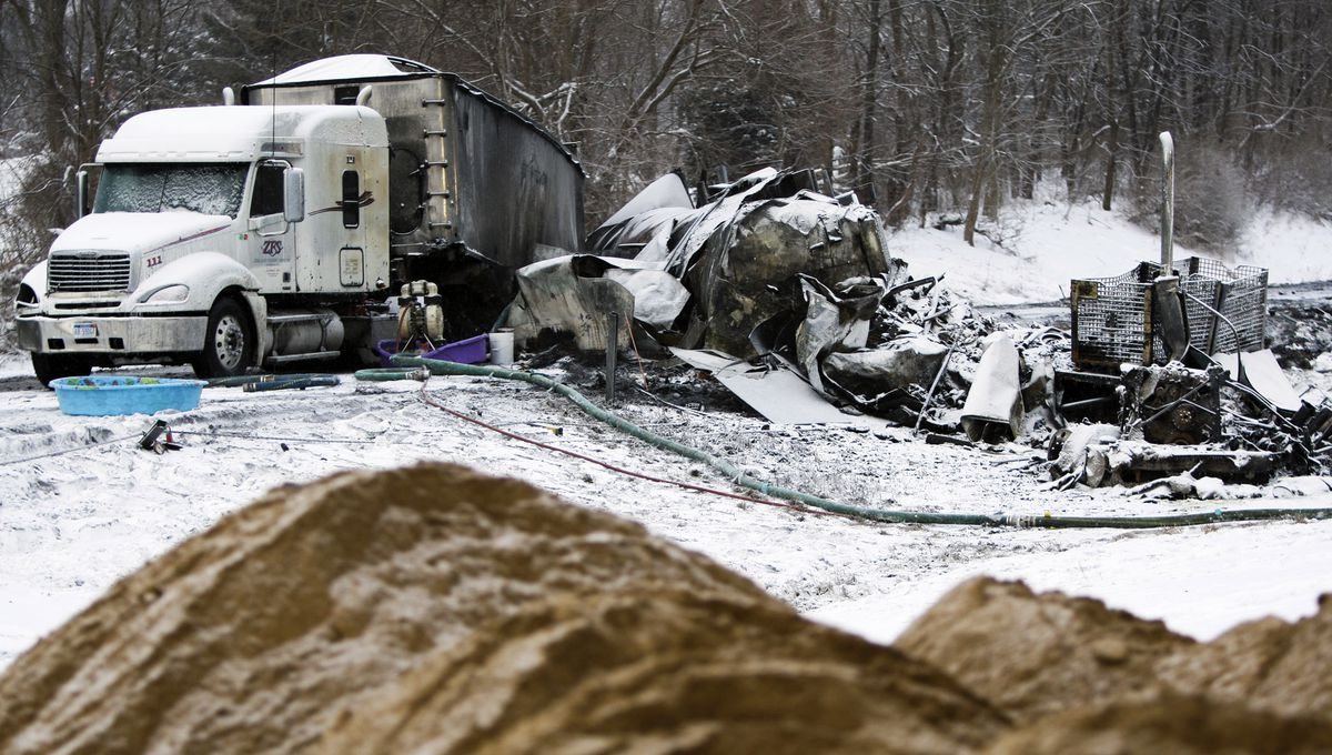 <small><strong>The charred remains of vehicles and debris sit on Interstate 94, Saturday, Jan. 10, 2015. | Christian Randolph / AP</strong><small></small></small>