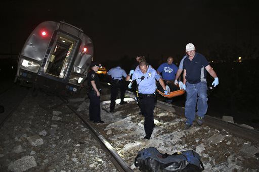 <small><strong>Emergency personnel work the scene of the deadly Amtrak train wreck Tuesday night in Philadelphia. | Joseph Kaczmarek/AP</strong></small>