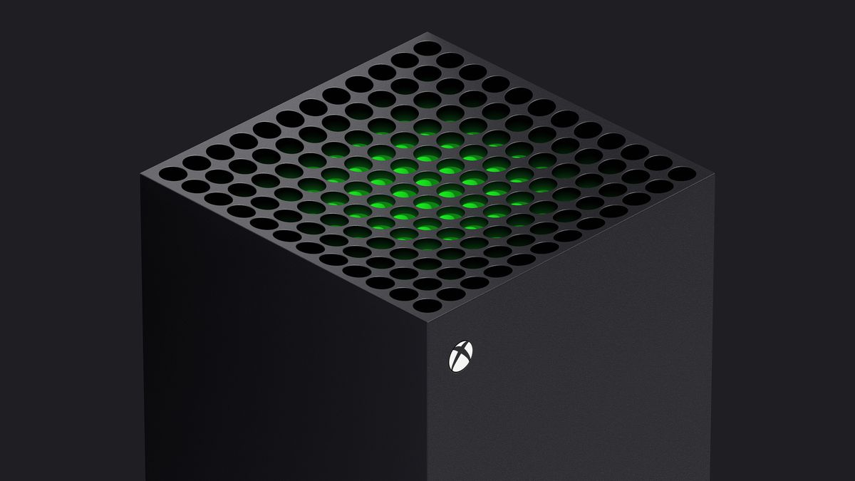 a three-quarter view of the top of the Xbox Series X with a green piece of plastic visible just below the system valves