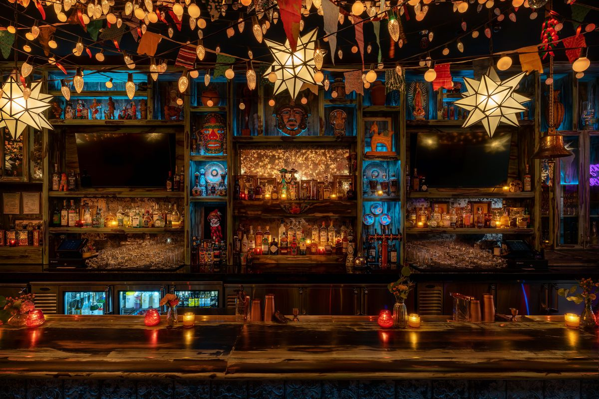A bar with a lot of small lights overhead