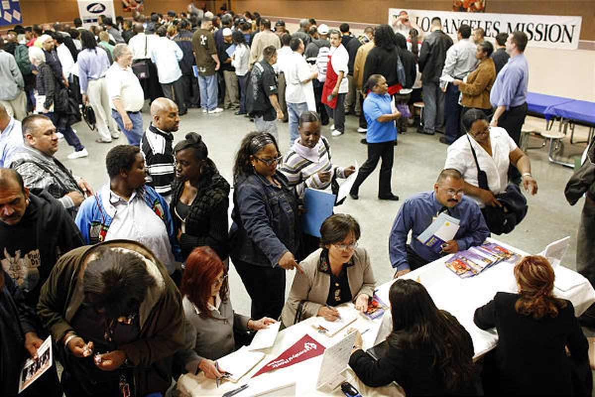 People look for jobs at the Los Angeles Mission Career Fair June 4. Employers cut 247,000 jobs in July.