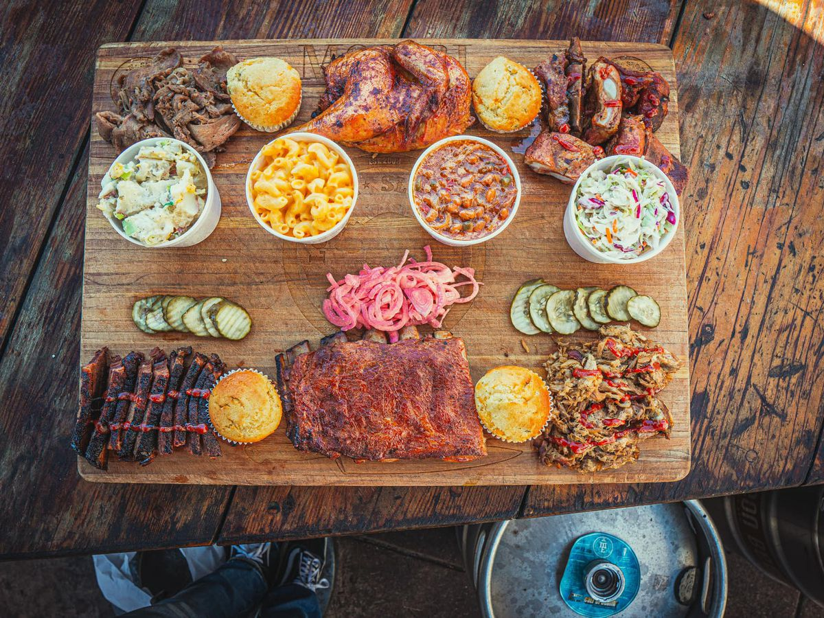 BBQ board filled with meats and pickles