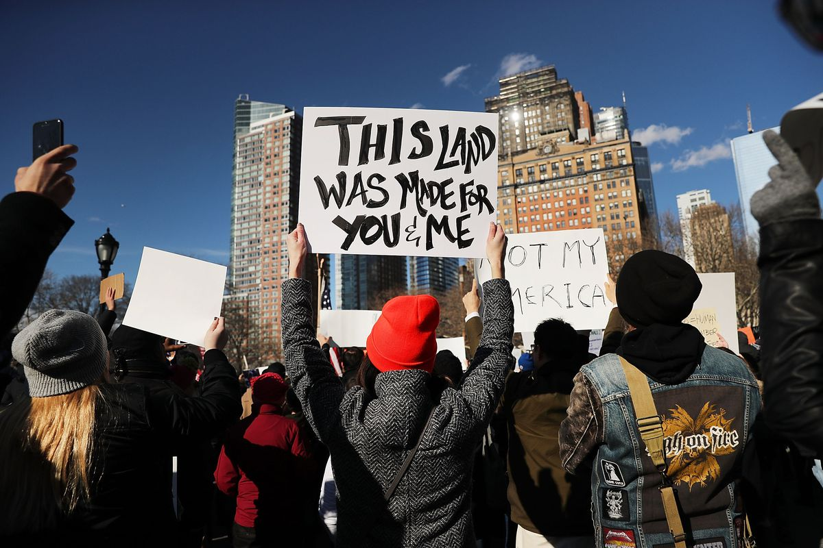 People attend an rally in Battery Park, in New York City, to protest US President Donald Trump's executive order on refugees.