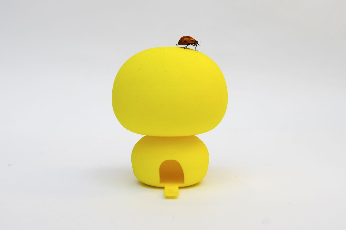 Ladybug on yellow 3d printed structure