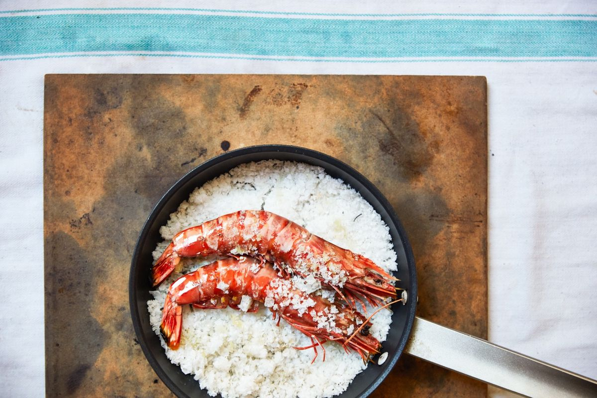 A red prawn duo on salt in a pan, for Claro Portuguese restaurant in Soho