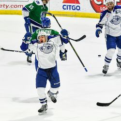Syracuse Crunch Alex Barré-Boulet (12) celebrates his goal against the Utica Comets in American Hockey League (AHL) action in the Adirondack Bank Center at the Utica Memorial Auditorium in Utica, New York on Friday, November 16, 2018. Syracuse won 4-0.