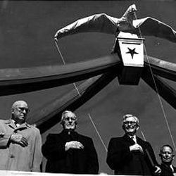 At the Eagle Gate dedication in 1963 were Utah Gov. George D. Clyde, left; Rt. Rev. Monsignor Patrick A. Maguire, Catholic pastor; LDS Church President David O. McKay and Commissioner Joe L. Christensen. The gate spans 74 feet, and the eagle weighs 4,000 pounds.