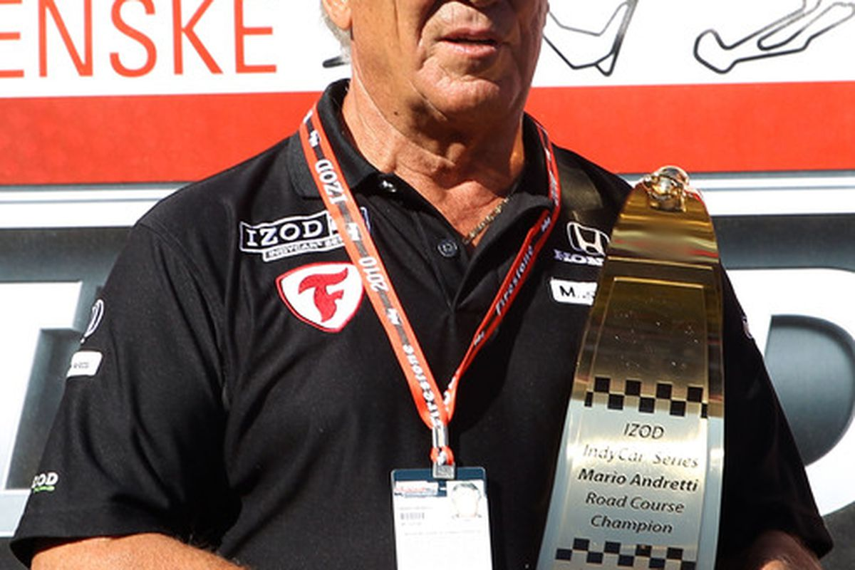 SONOMA CA - AUGUST 22:   Mario Andretti stands with Road Championship Trophy after the IZOD IndyCar Series Grand Prix of Sonoma at Infineon Raceway on August 22 2010 in Sonoma California.  (Photo by Christian Petersen/Getty Images)