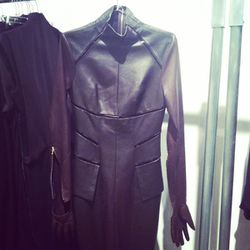 This Todd Lynn leather dress features built-in gloves.