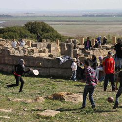 In this March 11, 2012 photo, Moroccan college students play in the Roman ruins of Lixus in northern Morocco.